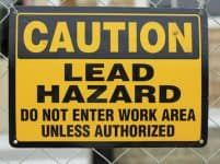 lead hazard caution sign on job site