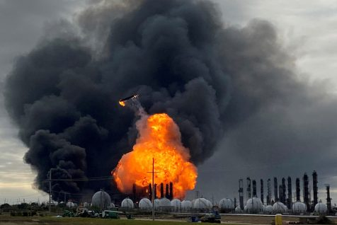 A process tower flies through air after exploding at the TPC Group Petrochemical Plant in Port Neches