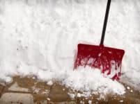 snow shovel in a snow bank