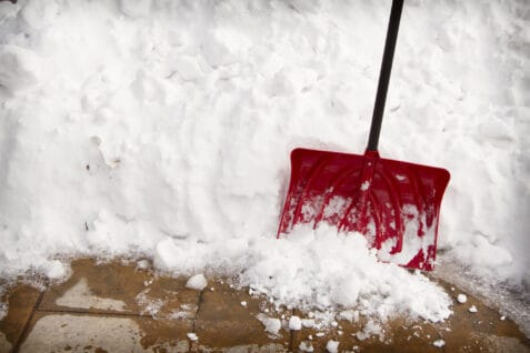 snow shovel in a snow bank