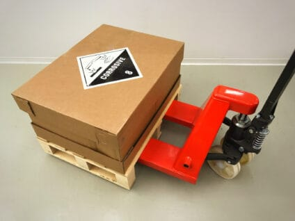 Hazardous delivery pallet and manual pallet truck.